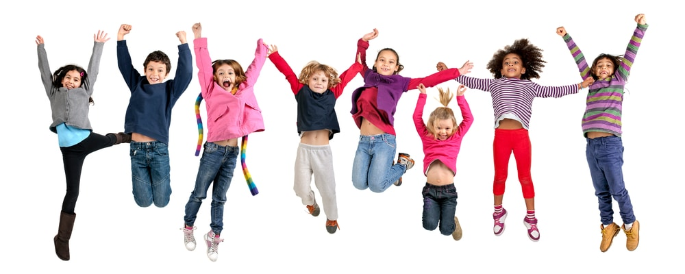 Eight children jumping in the air