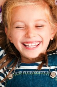 Little Girl Laughing With Eyes Closed