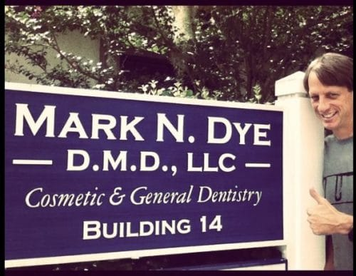 Picture of Tony Hawk in front of Mark Dye DMD sign